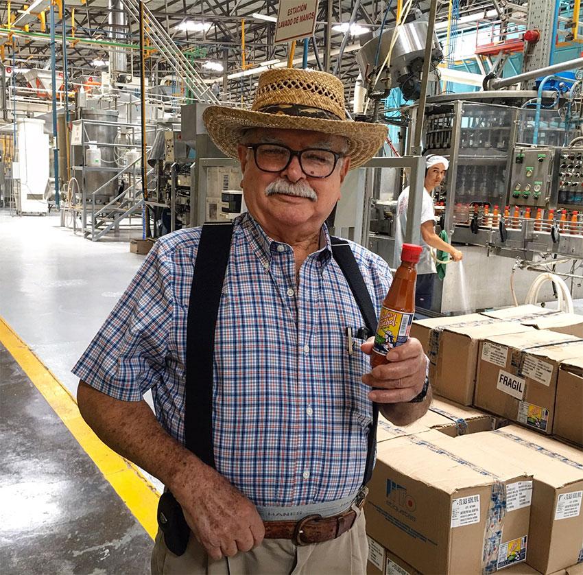 Roberto López in his salsa factory.