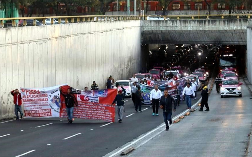 Taxi drivers march in Mexico City on Monday.