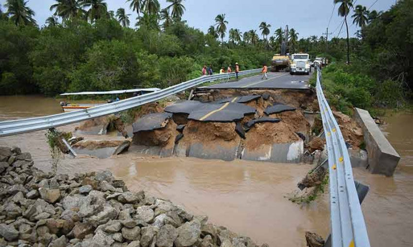 Washed-out bridges and mudslides cut off many communities in Guerrero.