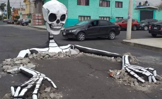 A skeleton surfaces in a street in Tláhuac, Mexico City.