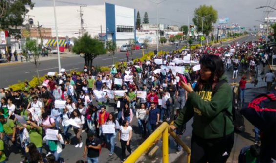 Students march in protest against violence in Celaya.