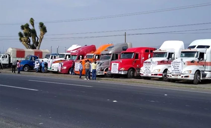 Striking truckers park their rigs at the roadside on Tuesday.