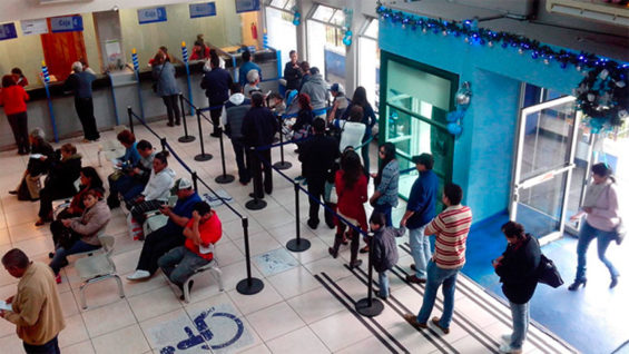 Water customers line up to pay their bills in Morelia, but many don't bother.