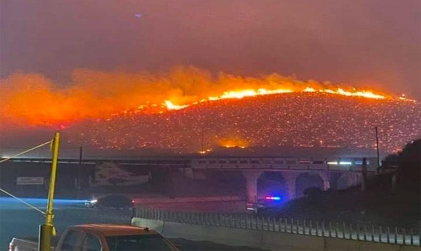 A wildfire burns yesterday in Tijuana.