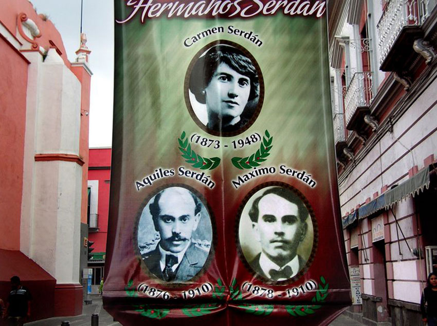 Banner with photos of the Serdán family celebrating the 100th anniversary of the Revolution.