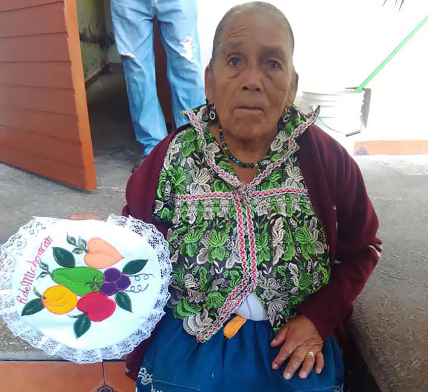 Doña Adela and her embroidery.