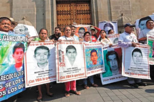 Parents of the missing students outside the National Palace after meeting with the president.