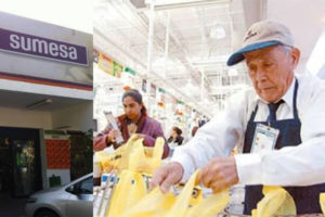 A senior bags groceries at a Sumesa store.