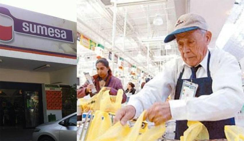 A senior bags groceries at a Sumesa store.