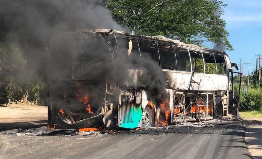 A bus burns on Friday in Petatlán, Guerrero.