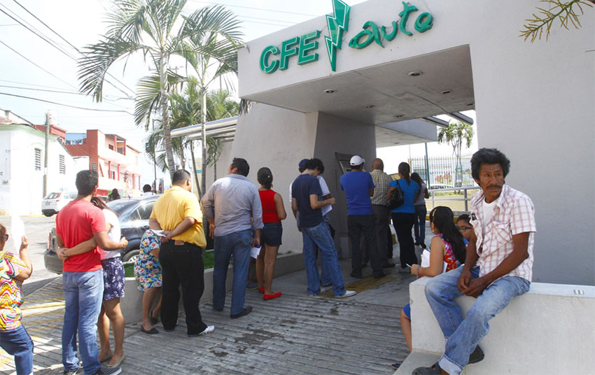 Customers line up to pay their electricity bills in Tabasco