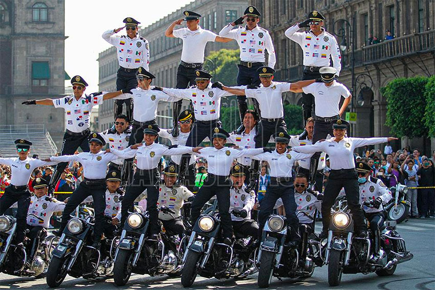 Mexico City traffic police motorcycle acrobatic team gives a demonstration on Sunday.