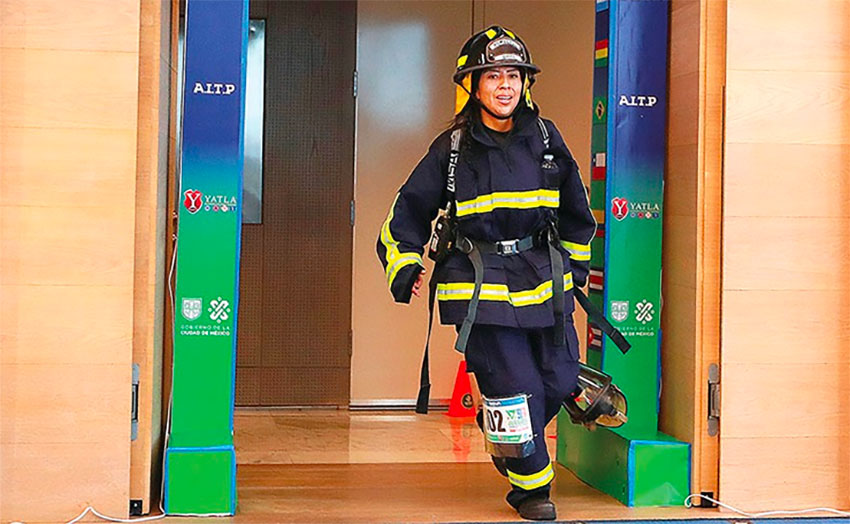 A firefighter completes the 50-story stair climb at the BBVA Tower in Mexico City.