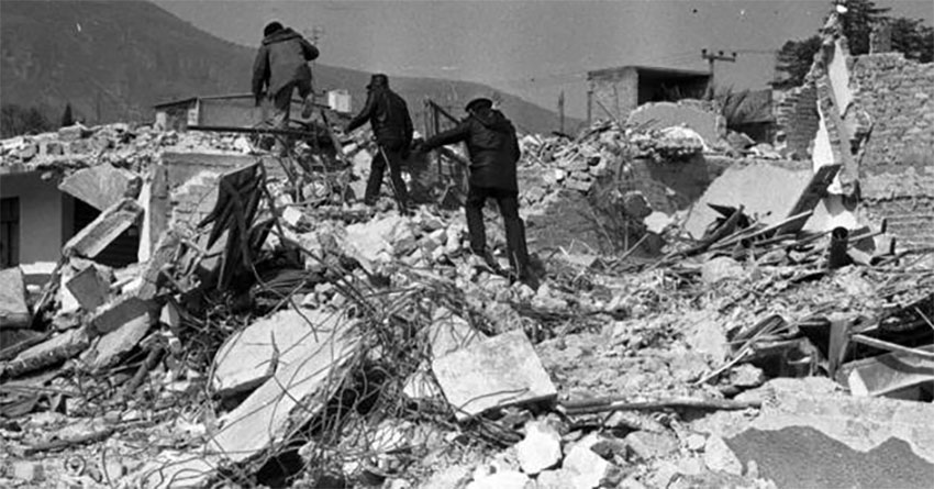 Searchers in the wreckage. More than 500 people were killed.