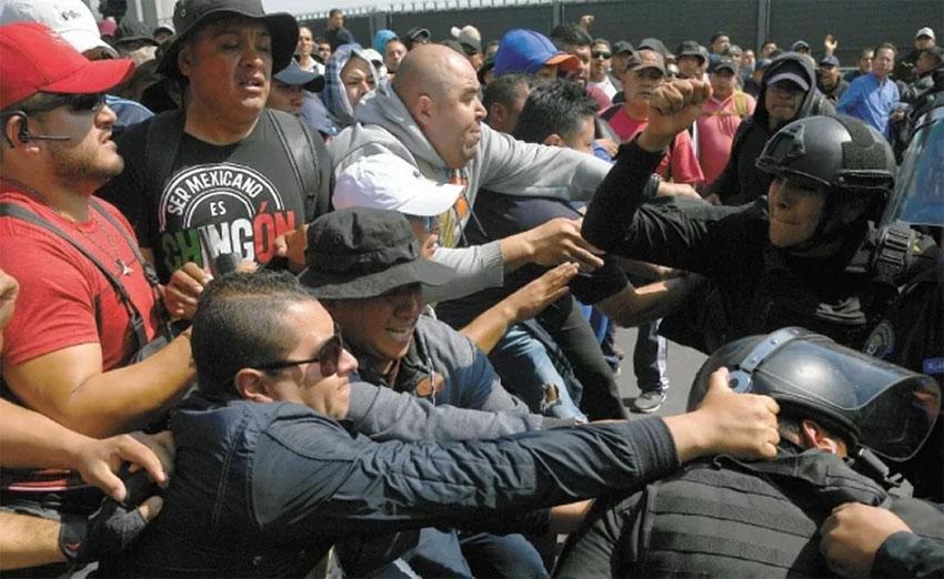 Cops vs. cops at Mexico City airport.
