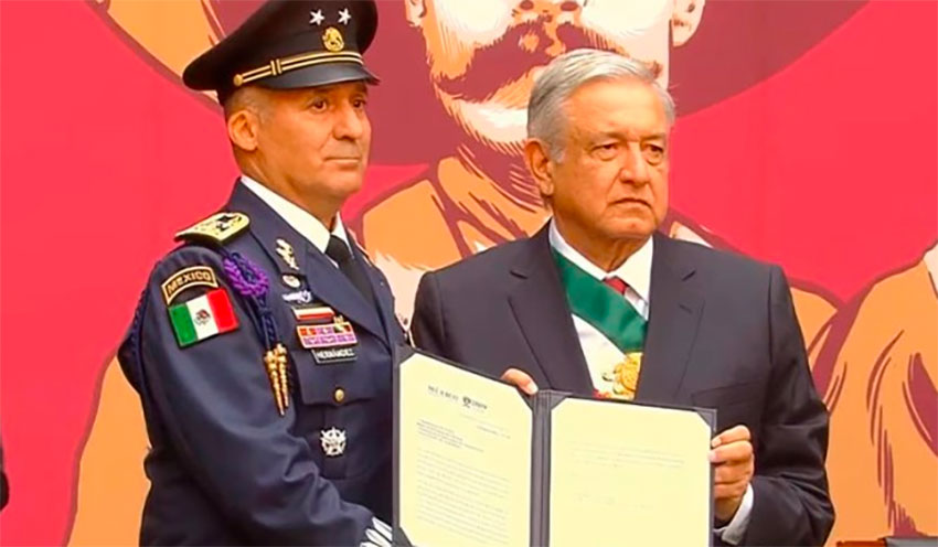 Air Force pilot Hernández receives his promotion for flying Bolivia's ex-president to Mexico.