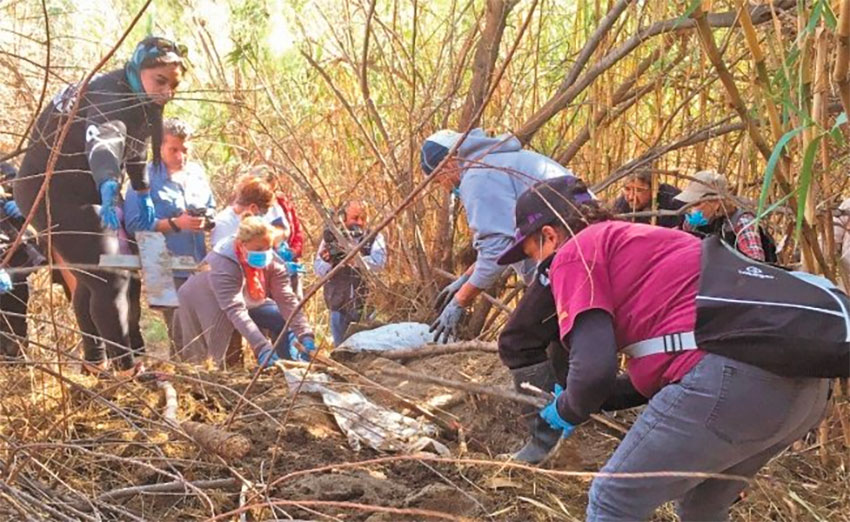 Searchers look for bodies Saturday in Tijuana.