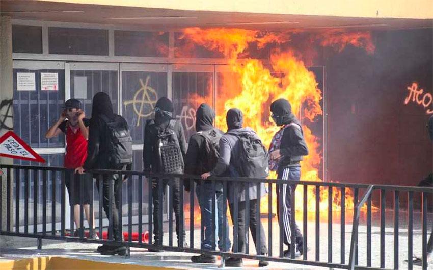 Vandals start a fire at a university bookstore on Thursday.