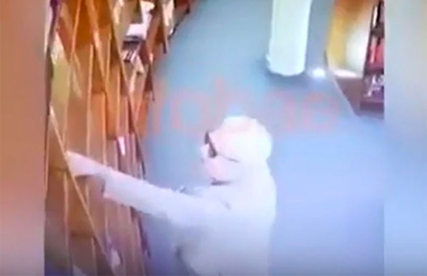 Video captures the ambassador taking a book of a shelf at a Buenos Aires bookstore.