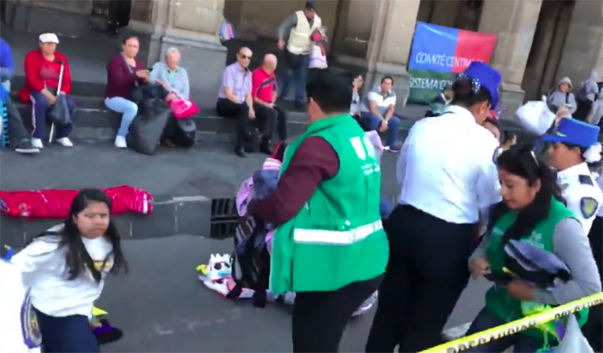 City officials clear vendors from the street on Sunday.