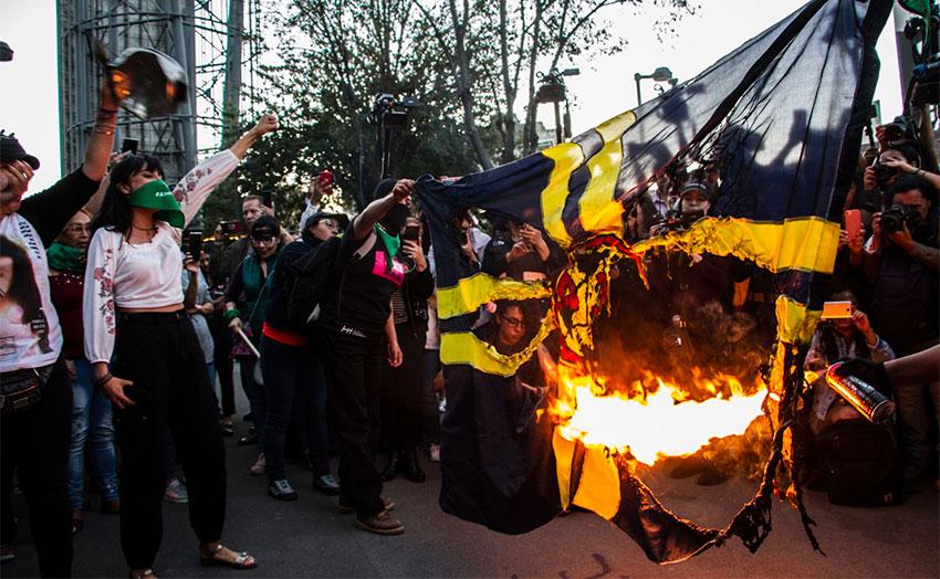 Women burn soccer club's flag in Mexico City.