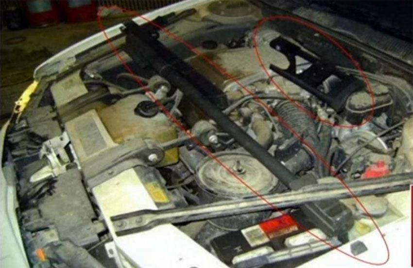A 50-caliber rifle hidden under the hood of a car.
