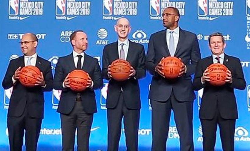 NBA commissioner Adam Silver, center, announces the new G League team.