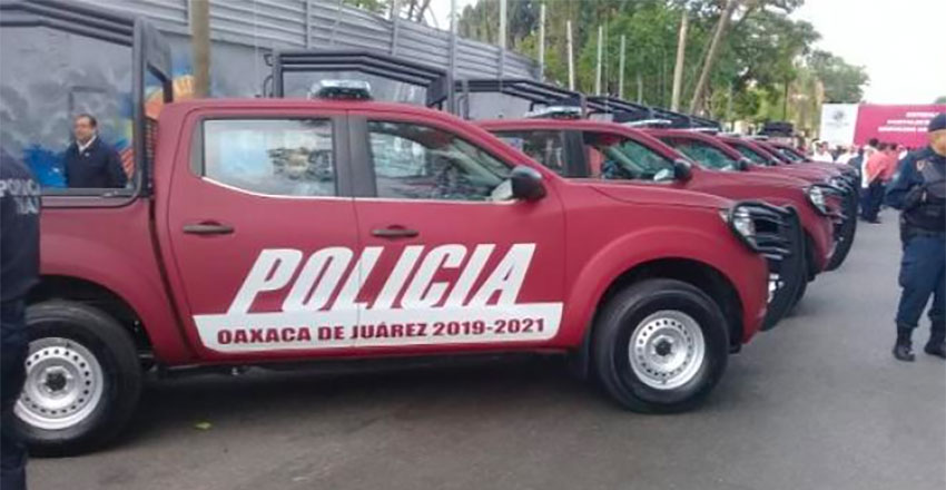 Oaxaca city police vehicles were painted Morena maroon earlier this year.