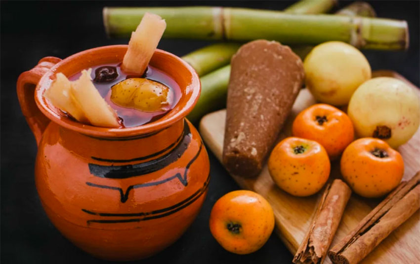 Fruit, piloncillo and cinnamon are among the ingredients in this mug of ponche.