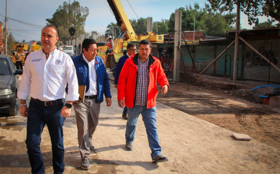San Miguel's mayor inspects the paving project on Sunday.