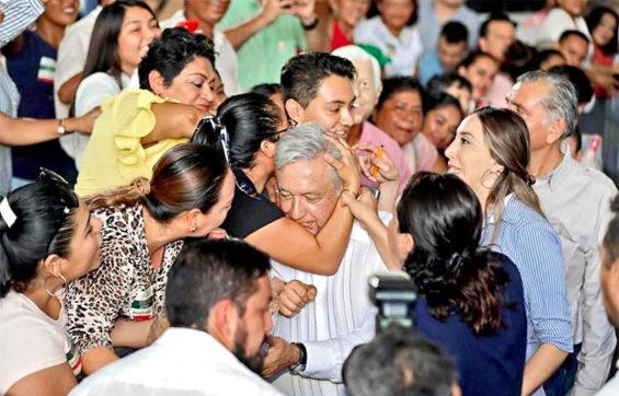 Hugs for AMLO in Tabasco.