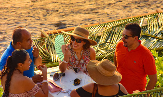 Guests enjoy wine festival on the beach at Zihuatanejo.