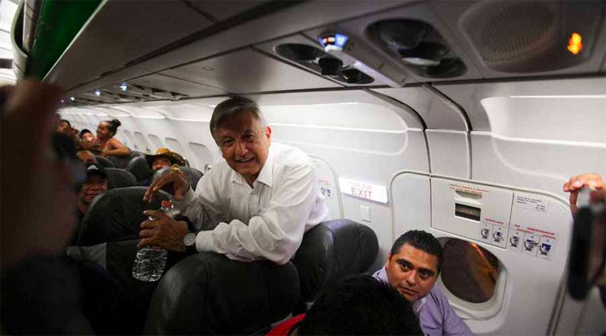 AMLO at home aboard a commercial flight.