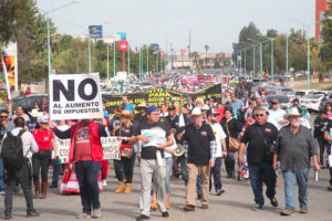 Brewery opponents march in Mexicali on Sunday.