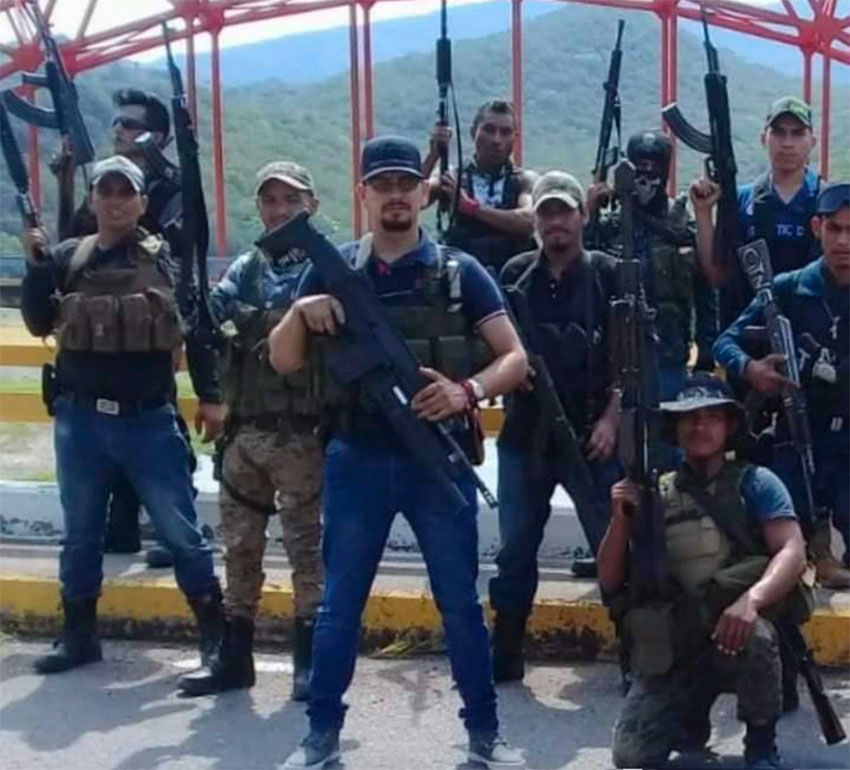Fernández, standing in foreground, and CJNG sicarios.