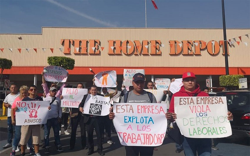 Workers protest outside a Home Depot in Mexico City.