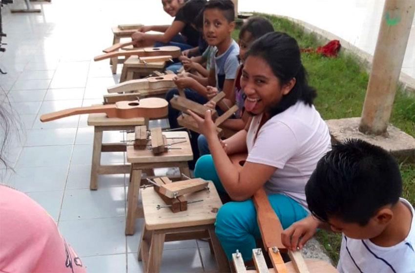 Young instrument makers in Veracruz.