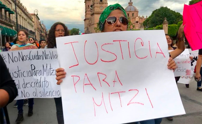 Protesters call for justice for a Michoacán journalist who was victim of an assault last September and then harassed by police.