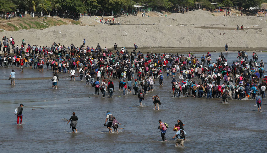 Migrants cross the Suchiate River at the Guatemala border.