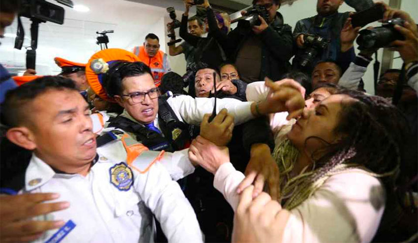 Police scuffle with parents protesting a shortage of cancer drugs.