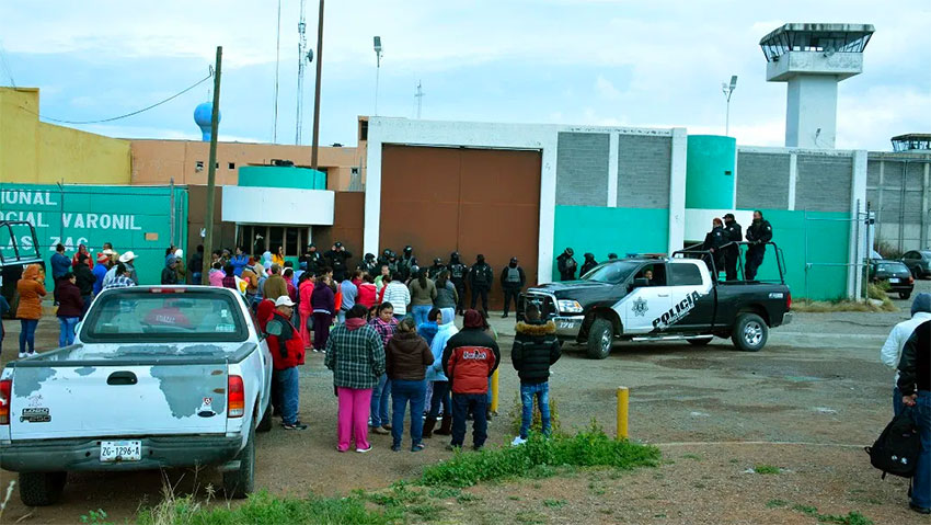 Inmates' families wait for news outside the Zacatecas prison.