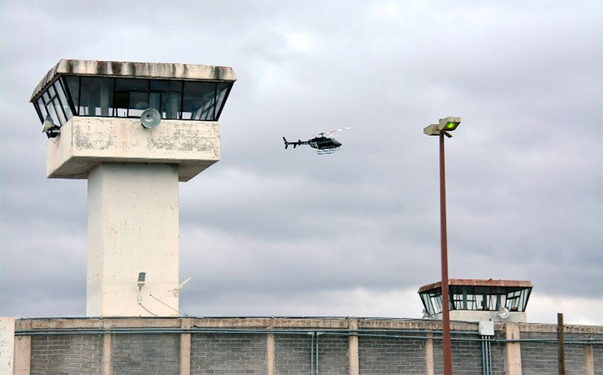 A helicopter flies over the Zacatecas prison where two riots have occurred this week.