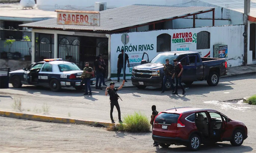 Cartel gangsters control a street corner in Culiacán in October.