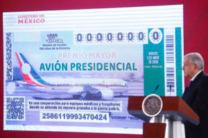 The president presents raffle ticket design at today's press conference.