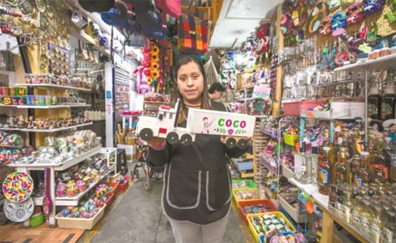 Toy vendor Rosario with a truck bearing the name of a popular film.