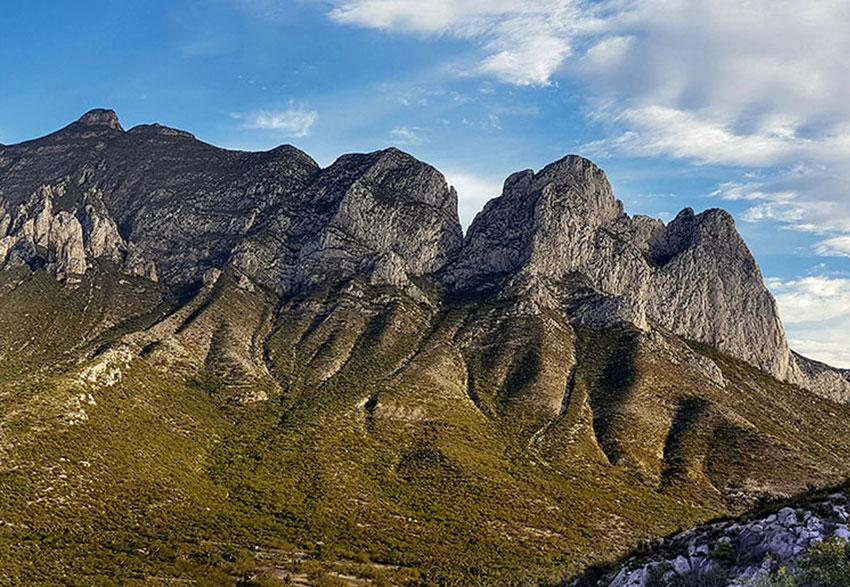 La Huasteca: limestone peaks rise above desert scrub.