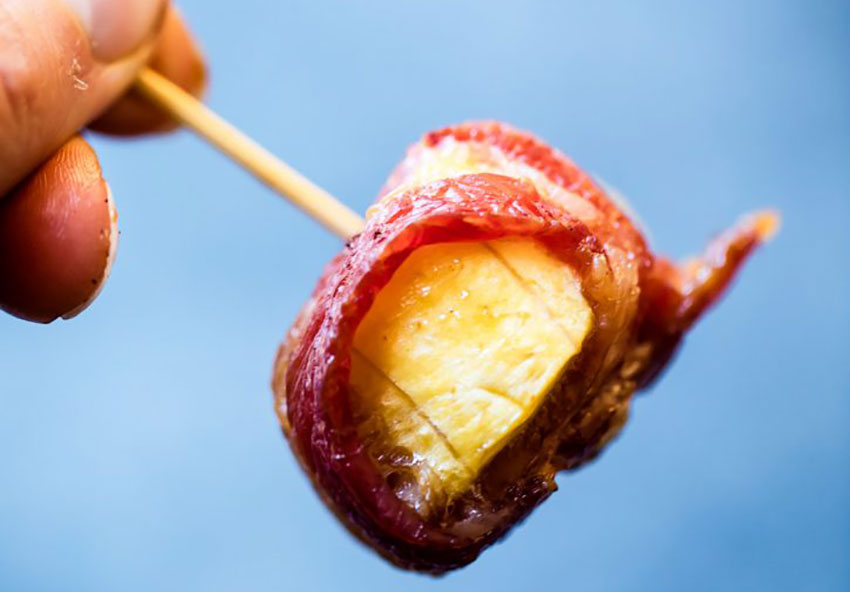 A tasty-looking bacon-wrapped plantain bite.
