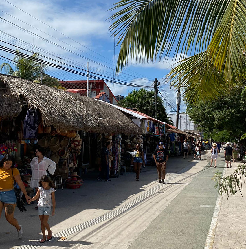 A street in Tulum makes the best of the new visitors.