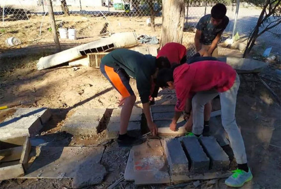 Youths at work on their building blocks.