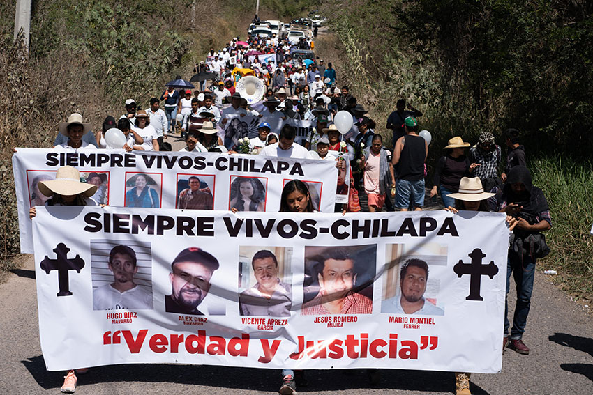 Hundreds of people attend a march to protest against the number of people who have been murdered or disappeared in Guerrero.